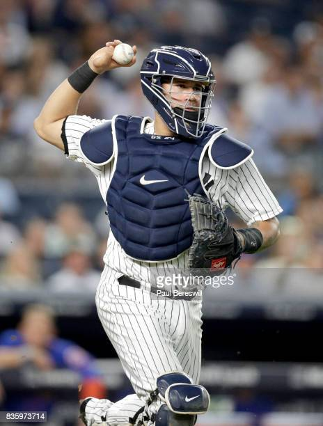 Catcher Gary Sanchez of the New York Yankees throws to first base in an MLB baseball game against the New York Mets on August 14 2017 at Yankee...