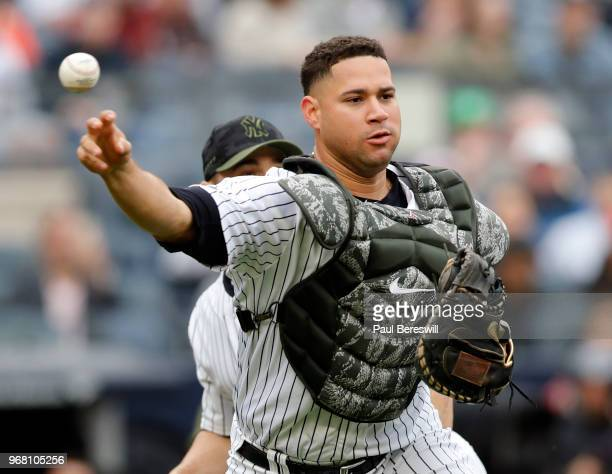 Catcher Gary Sanchez of the New York Yankees throws to first base in an MLB baseball game against the Los Angeles Angels of Anaheim on May 27, 2018...