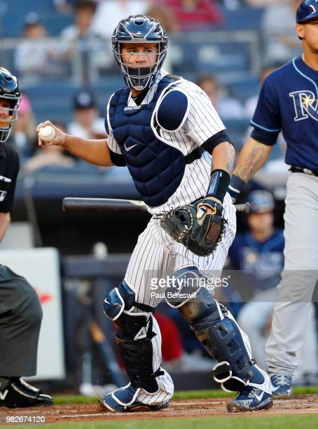 Catcher Gary Sanchez of the New York Yankees throws to first base in an MLB baseball game against the Tampa Bay Rays on June 15 2018 at Yankee...