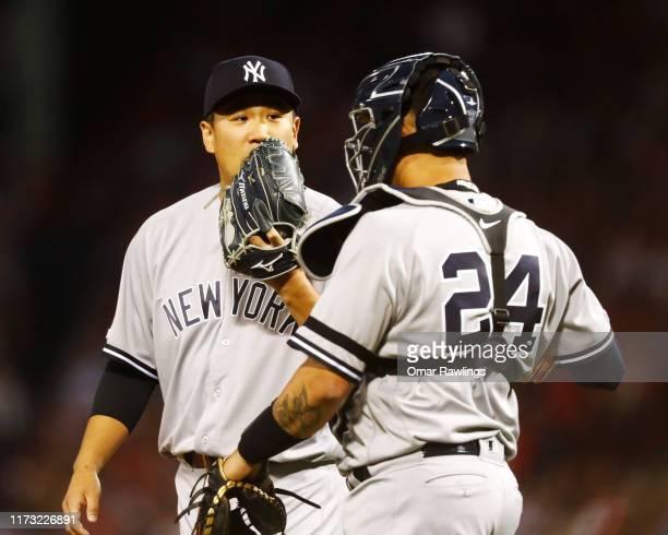 Catcher Gary Sanchez of the New York Yankees visits Starting pitcher Masahiro Tanaka of the New York Yankees on the mound in the bottom of the first...