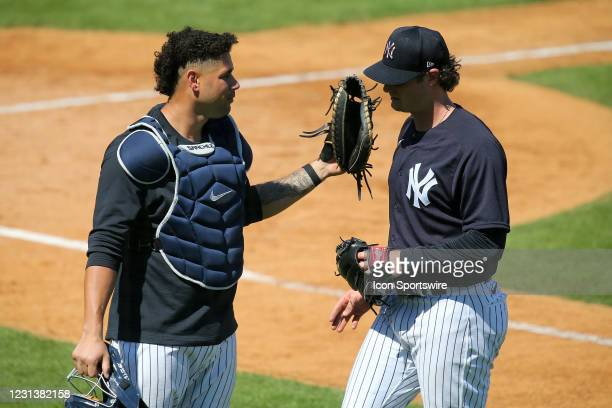 Catcher Gary Sanchez of the Yankees congratulates pitcher Gerrit Cole during the New York Yankees spring training work out on February 25 at...