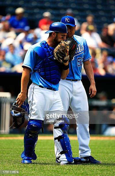 Catcher George Kottaras of the Kansas City Royals talks with pitcher Bruce Chen during the game against the Oakland Athletics at Kauffman Stadium on...