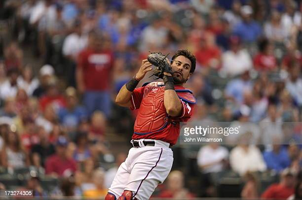 Catcher Geovany Soto of the Texas Rangers fields his position as he catches a foul fly ball in the game against the Houston Astros at Rangers...