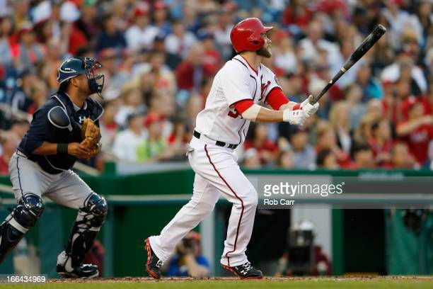 Catcher Gerald Laird of the Atlanta Braves looks on as Bryce Harper of the Washington Nationals follows his two RBI home run during the first inning...
