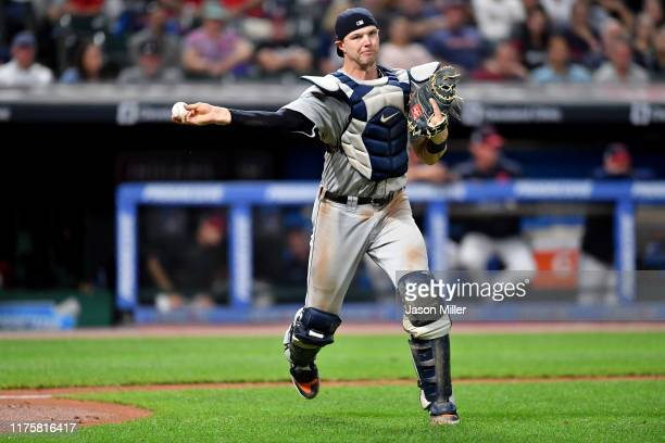 Catcher Grayson Greiner of the Detroit Tigers throws out Leonys Martin of the Cleveland Indians at first to end the fifth inning at Progressive Field...