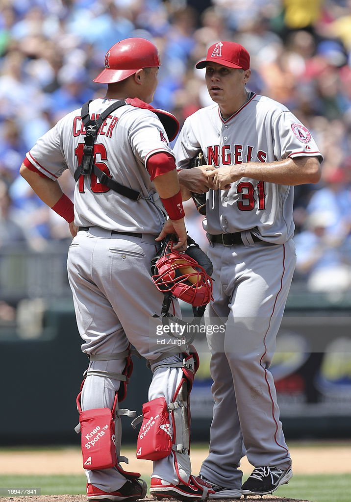 Catcher Hank Conger #16 of the Los Angeles Angels of Anaheim talks with staring pitcher Billy Buckner #31 during the fifth inning of a game against the Kansas City Royals at Kauffman Stadium on May 25, 2013 in Kansas City, Missouri.