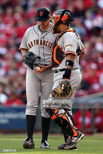 Catcher Hector Sanchez of the San Francisco Giants talks with pitcher Barry Zito in the first inning against the Cincinnati Reds in Game Four of the...