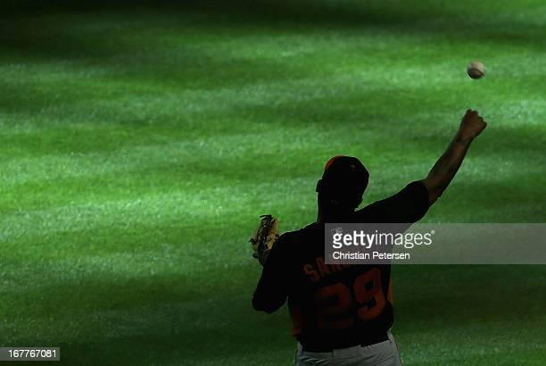 Catcher Hector Sanchez of the San Francisco Giants warms up before the MLB game against the Arizona Diamondbacks at Chase Field on April 29 2013 in...