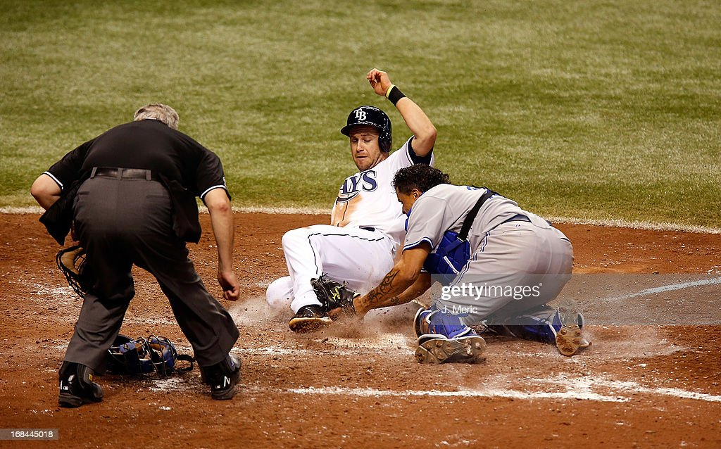 Catcher Henry Blanco #22 of the Toronto Blue Jays tags out Evan Longoria #3 of the Tampa Bay Rays in the eighth inning as he tried to score from third during the game at Tropicana Field on May 9, 2013 in St. Petersburg, Florida.