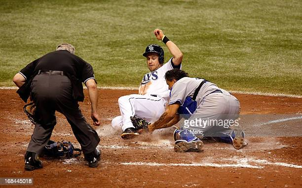 Catcher Henry Blanco of the Toronto Blue Jays tags out Evan Longoria of the Tampa Bay Rays in the eighth inning as he tried to score from third...