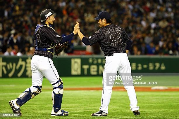 Catcher Hikaru Ito and pitcher Tomomi Takahashi of Samurai Japan celebrate after winning the game two of Samurai Japan and MLB All Stars at Tokyo...