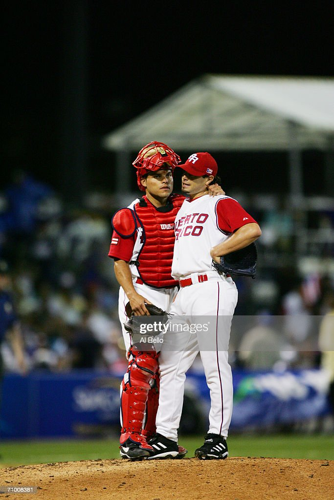 Catcher Ivan Rodriguez of Puerto Rico talks to pitcher Joel Pineiro during the game against Venezuela in the second round of the World Baseball Classic at Hiram Bithorn Stadium on March 13, 2006 in San Juan, Puerto Rico. Venezuela defeated Puerto Rico 6-0.