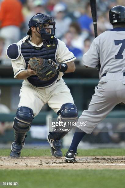 Catcher Ivan Rodriguez of the Detroit Tigers looks to throw during the game against the Chicago White Sox on July 31 2004 in Detroit Michigan The...