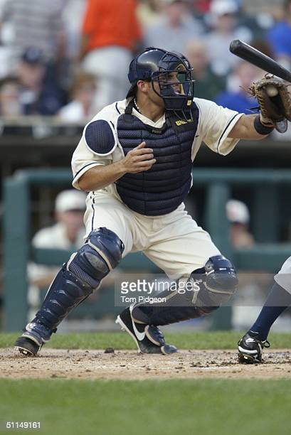 Catcher Ivan Rodriguez of the Detroit Tigers makes a catch during the game against the Chicago White Sox on July 31 2004 in Detroit Michigan The...