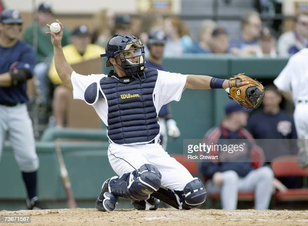 Catcher Ivan Rodriguez of the Detroit Tigers throws the ball to the mound during a Spring Training game against the Cleveland Indians on March 32007...