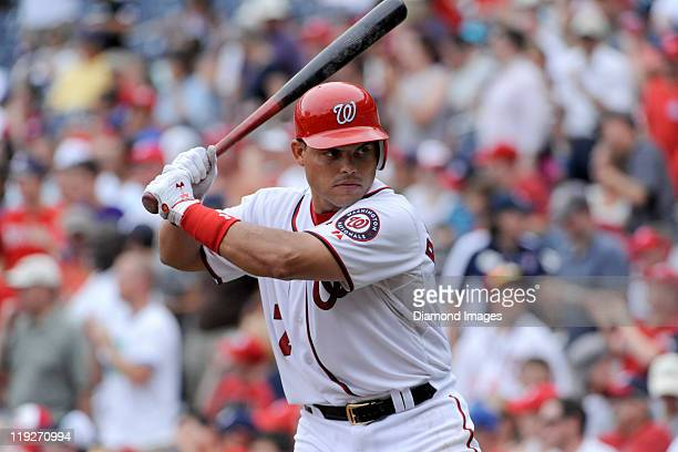 Catcher Ivan Rodriguez of the Washington Nationals takes a practice swing prior to stepping into the batters box during the bottom of the ninth...