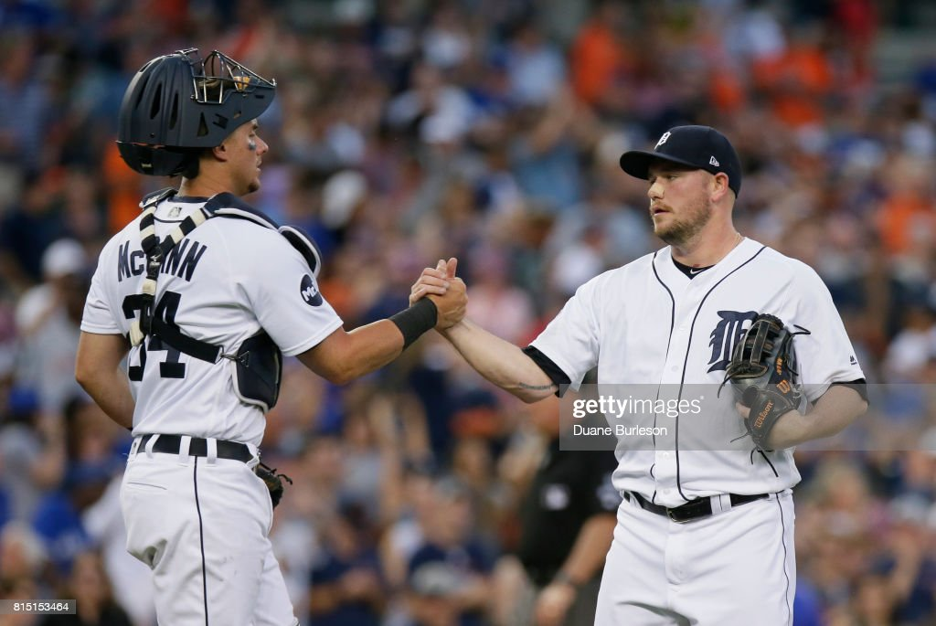 Catcher James McCann #34 of the Detroit Tigers celebrates with pitcher Alex Wilson #30 of the Detroit Tigers after a 11-1 win over the Toronto Blue Jays at Comerica Park on July 15, 2017 in Detroit, Michigan.