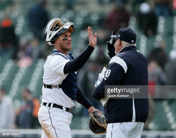 Catcher James McCann of the Detroit Tigers highfives with manager Ron Gardenhire of the Detroit Tigers after a win over the Kansas City Royals at...