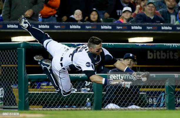 Catcher James McCann of the Detroit Tigers makes the catch on a foul ball hit by Joey Gallo of the Texas Rangers during the seventh inning at...