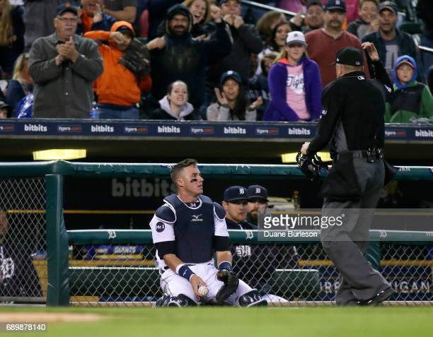 Catcher James McCann of the Detroit Tigers sits on the field after catching a foul ball hit by Joey Gallo of the Texas Rangers during the seventh...