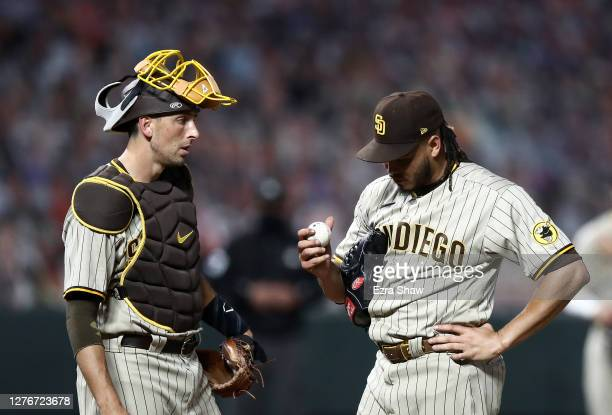 Catcher Jason Castro speaks to Dinelson Lamet of the San Diego Padres before he is taken out of the game against the San Francisco Giants with an...