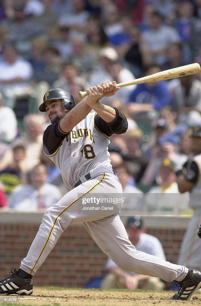 Catcher Jason Kendall #18 of the Pittsburgh Pirates swings at a pitch during the MLB game against the Chicago Cubs at Wrigley Field in Chicago, Illinois on May 23, 2002. The Cubs won 11-6.