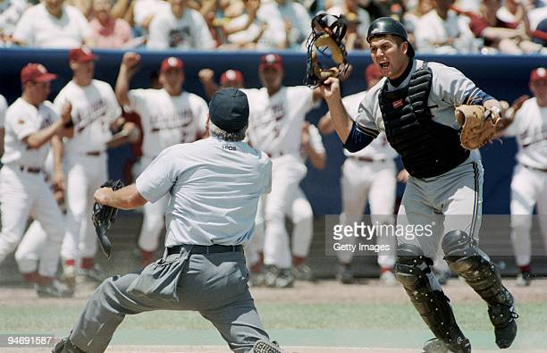 Catcher Jason Varitek of Georgia Tech Yellowjackets argues the Safe call from the umpire during the 1994 NCAA College Baseball World Series game...