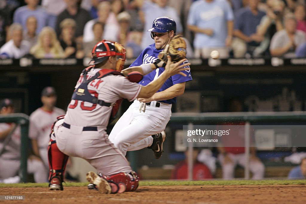Catcher Jason Varitek of the Boston Red Sox attempts to make a tag against Denny Hocking of the Kansas City Royals at Kauffman Stadium in Kansas City, Mo. on August 25, 2005. The Royals won 7-4.