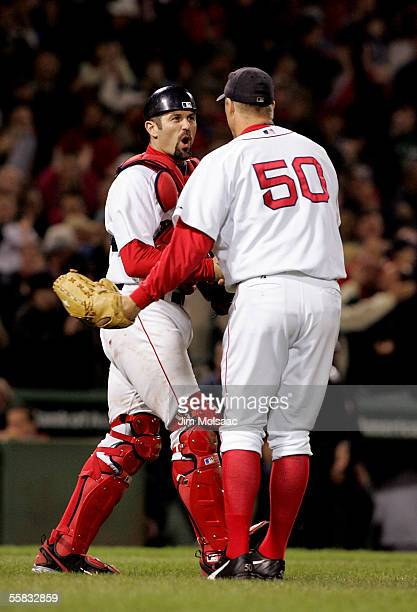 Catcher Jason Varitek of the Boston Red Sox celebrates with closing pitcher Mike Timlin after defeating the New York Yankees 53 at Fenway Park on...