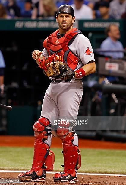 Catcher Jason Varitek of the Boston Red Sox looks in the dugout for a sign against the Tampa Bay Rays during the game at Tropicana Field on July 17...
