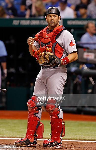 Catcher Jason Varitek of the Boston Red Sox looks into the dugout for the call against the Tampa Bay Rays during the game at Tropicana Field on July...