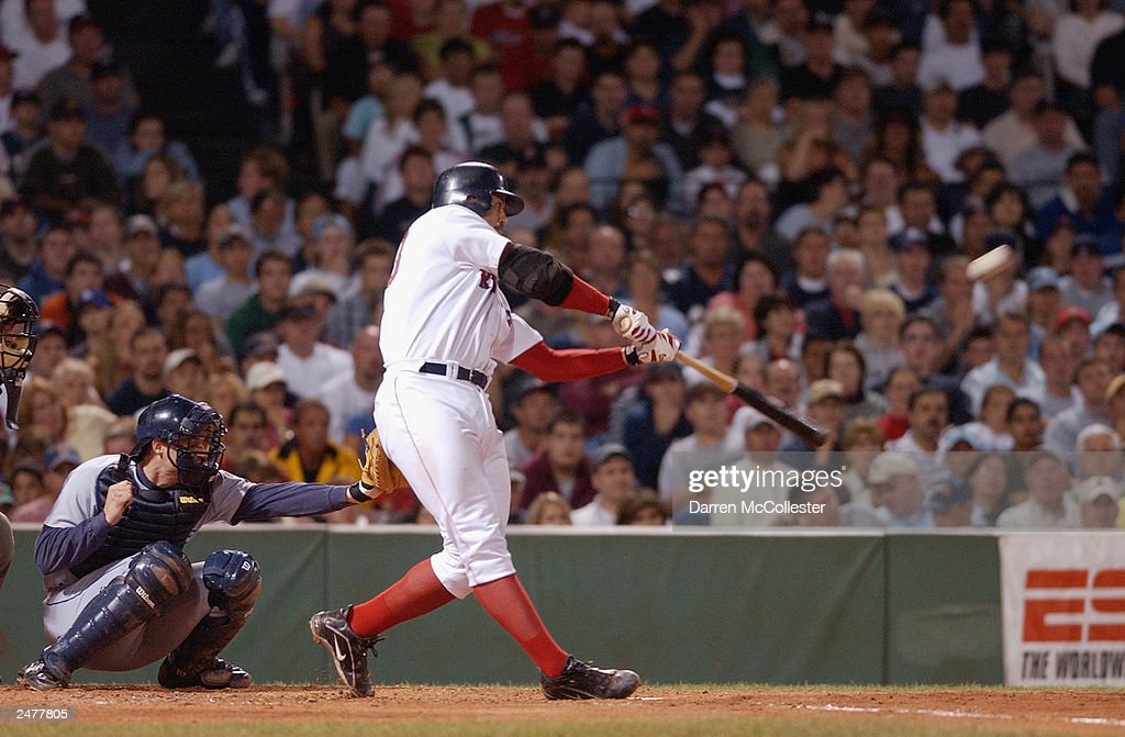 Catcher Jason Varitek #33 of the Boston Red Sox swings at a pitch during the game against the Seattle Mariners at Fenway Park August 24, 2003 in Boston, Massachusetts.