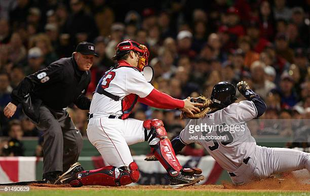 Catcher Jason Varitek of the Boston Red Sox tags-out runner Hideki Matsui of the New York Yankees on a fielder's choice play in the second inning...