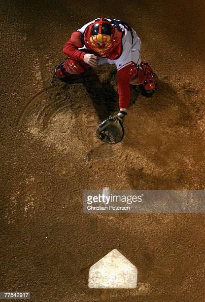 Catcher Jason Varitek of the Boston Red Sox warms up pitcher Jon Lester in the bullpen before Game Four of the 2007 World Series against the Colorado...