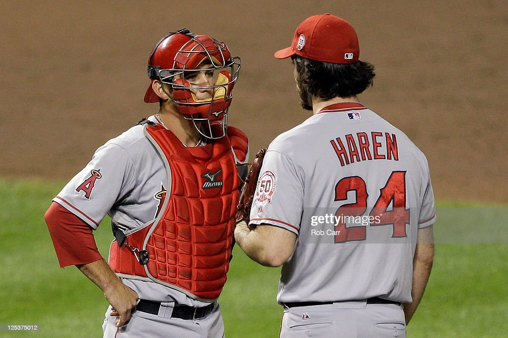 Catcher Jeff Mathis #5 of the Los Angeles Angels of Anaheim talks with pitcher Dan Haren during the fifth inning against the Baltimore Orioles at Oriole Park at Camden Yards on September 16, 2011 in Baltimore, Maryland. The Orioles won 8-3.