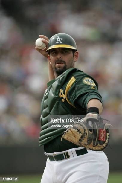 Catcher Jeremy Brown of the Oakland Athletics throws during the Spring Training game against the Chicago Cubs at Phoenix Municipal Stadium on March 6...