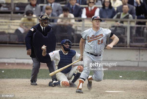 Catcher Jerry Grote of the New York Mets prepares to throw it back to the pitcher after Boog Powell of the Baltimore Orioles swung and missed during...