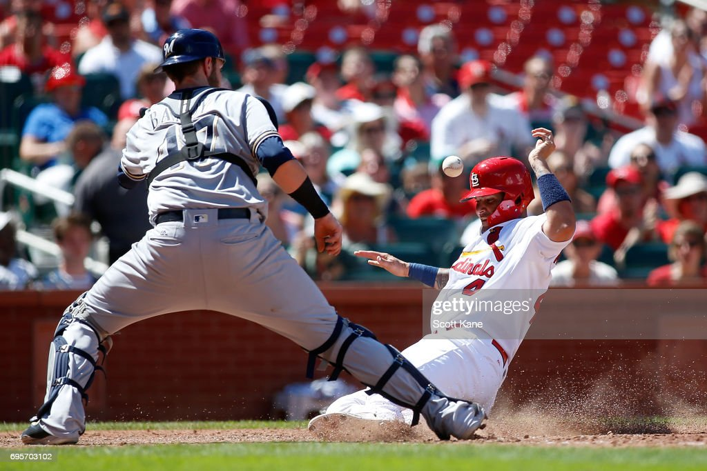 Catcher Jett Bandy #47 of the Milwaukee Brewers waits for the ball as Yadier Molina #4 of the St. Louis Cardinals scores a run during the sixth inning at Busch Stadium on June 13, 2017 in St. Louis, Missouri.