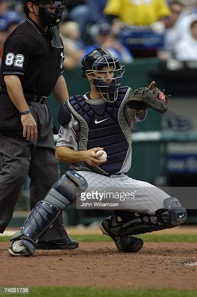 Catcher Joe Mauer of the Minnesota Twins appeals a check swing to the first base umpire during the game against the Kansas City Royals at Kauffman...