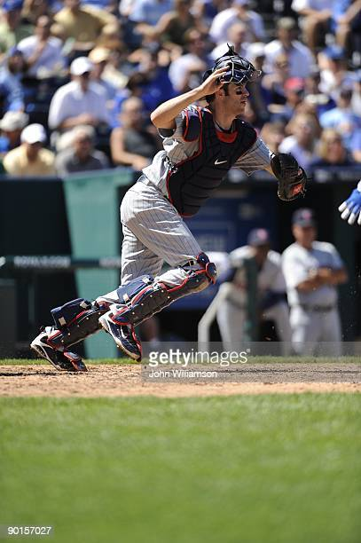 Catcher Joe Mauer of the Minnesota Twins fields his position as he runs from behind home plate to field a bunt attempt during the game against the...
