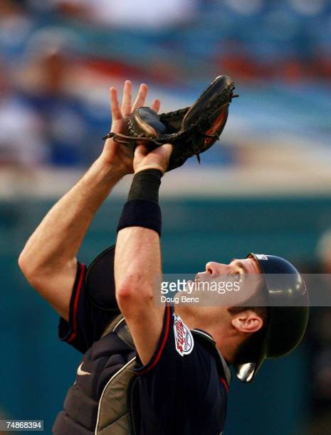 Catcher Joe Mauer of the Minnesota Twins waits to catch a pop-up behind home plate against the Florida Marlins during interleague play at Dolphin...