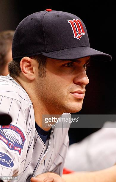 Catcher Joe Mauer of the Minnesota Twins watches his team against the Tampa Bay Rays during the game at Tropicana Field on May 31 2009 in St...