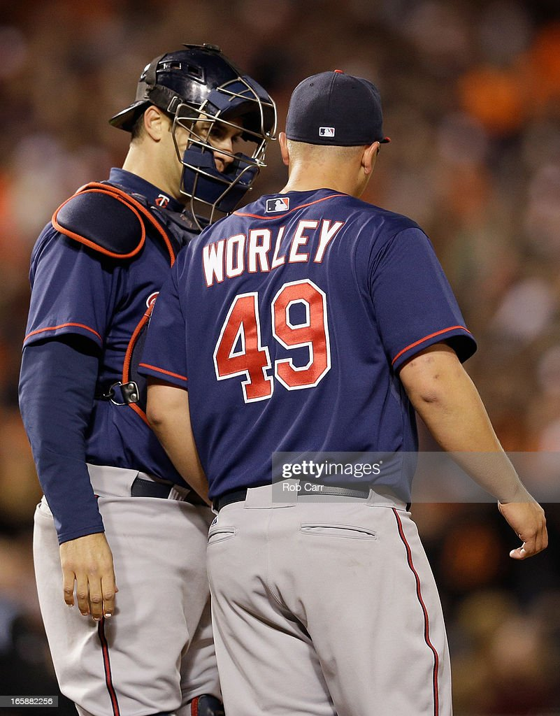 Catcher Joe Mauer #7 talks with starting pitcher Vance Worley #49 of the Minnesota Twins during the fifth inning of the Twins 6-5 win over the Baltimore Orioles at Oriole Park at Camden Yards on April 6, 2013 in Baltimore, Maryland.