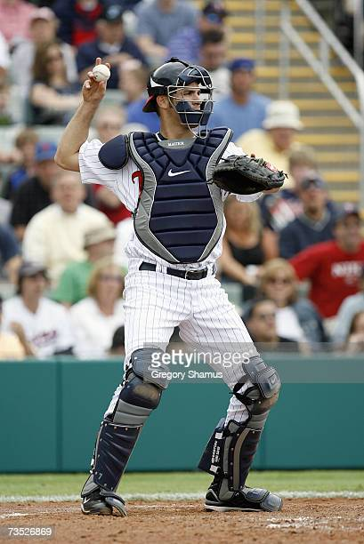 Catcher Joe Mauer#7 of the Minnesota Twins tosses the ball to the mound during a Spring Training game against the Boston Red Sox on March 4, 2007 at...