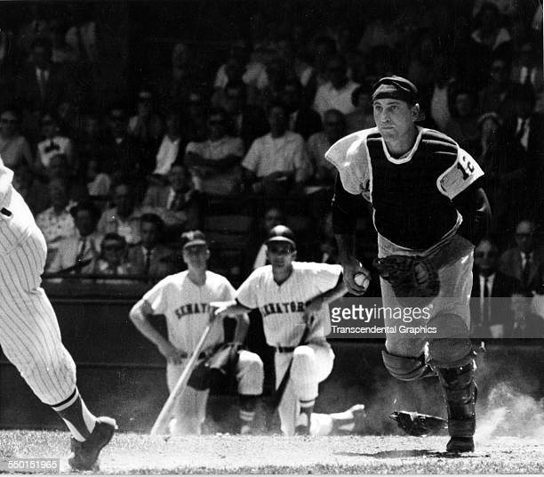 Catcher Joe Pignatano of the Kansas City Athletics in pursuit of a Washington Senators' base runner during an American League game in Griffith...