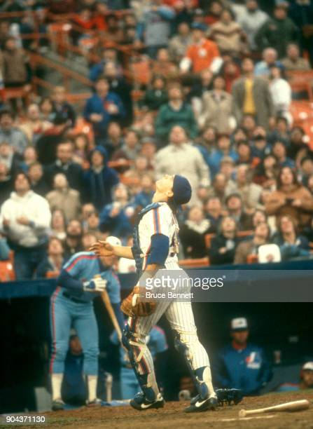 Catcher John Gibbons of the New York Mets looks up for the ball during an MLB game against the Montreal Expos on April 19 1984 at Shea Stadium in...