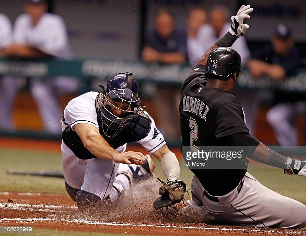 Catcher John Jaso of the Tampa Bay Rays tags out Hanley Ramirez of the Florida Marlins as he attempts to score during the game at Tropicana Field on...