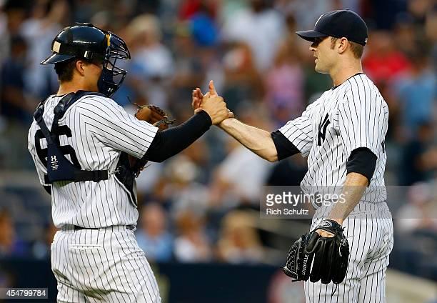 Catcher John Ryan Murphy of the New York Yankees congratulates closer David Robertson after defeating the Kansas City Royals 62 in a MLB baseball...