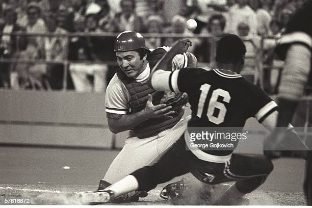 Catcher Johnny Bench of the Cincinnati Reds can't hold on to the ball as outfielder Al Oliver of the Pittsburgh Pirates slides home at Three Rivers...