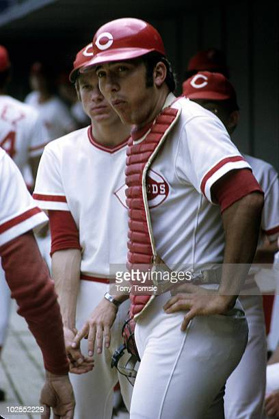 Catcher Johnny Bench of the Cincinnati Reds stands in the dugout during an MLB game circa 1970's at Riverfront Stadium in Cincinnati Ohio